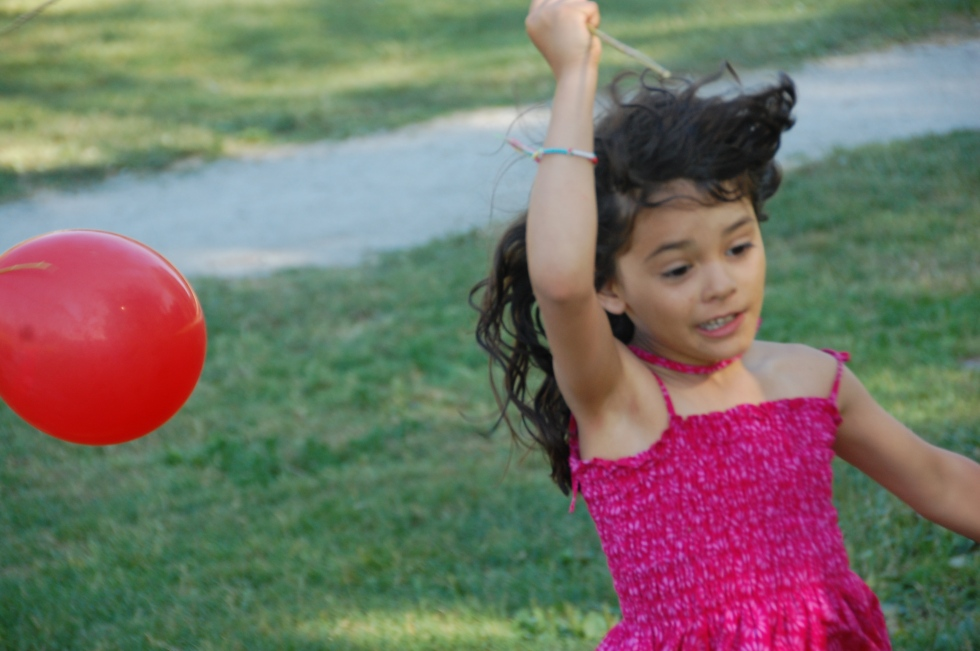 Isa running with a balloon